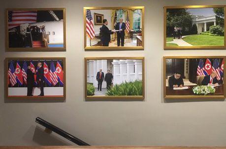 트럼프, 마크롱 떼고 김정은 사진 걸었다